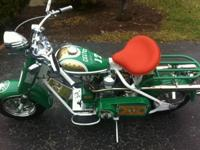 You are looking at a fully restored 1957 Cushman Eagle
