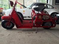 This is a completely restored 1957 CUSHMAN HIGHLANDER