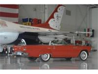 1957 Thunderbird - red with white interior. Original