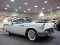 A 1957 Ford Thunderbird, with a white exterior and red