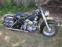 1957 Harley Davidson FLH Panhead. This bike looks and