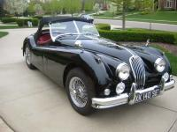 1957 Jaguar XK140 MC Roadster black with red interior.