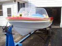 THIS IS A 1957 LONE STAR 16 FOOT FIBERGLAS BOAT BROUGHT