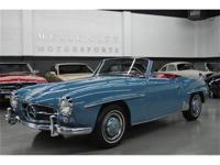 This 1957 Mercedes-Benz 190SL 2dr Sl features a 4 cyl