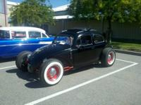 This is a 1957 Volkswagen Rat Rod. It is a hiboy with