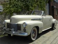 1958 Cadillac Series 62 Convertible. Turquoise with