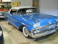 This Phantom Blue 1958 Chevrolet Impala Convertible is