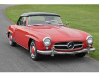 A 1958 Mercedes 190SL Roadster, red with a grey leather