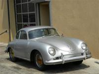 1958 Porsche 356A Coupe. Silver with black interior.