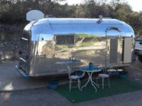 SHE IS 16' LONG OF TRAVEL TRAILER AND 19' FROM BUMPER