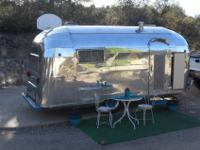 HERE IS ONE OF THE COOLEST VINTAGE TRAVEL TRAILERS OUT