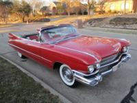 1959 Cadillac Series  62 Convertible.   He bought it