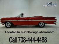 1959 Chevrolet Impala Convertible that has been frame