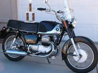 250 cc V-twin with four speed tranmission, shaft