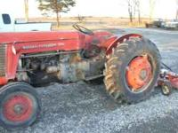 This is a 1959 massey ferguson 65 tractor with 4