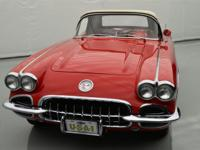 This 1960 Corvette is presented in Roman Red with white
