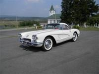 1960 Chevrolet Corvette. Ermine White exterior with a
