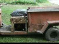 This is a 1960 Cushman Truckster. It has been sitting