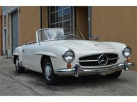 1960 Mercedes Benz 190SL. White with red interior.