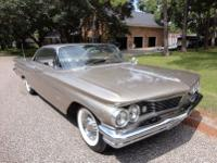 This is a 1960 Pontiac Bonneville two door hardtop.