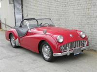 1960 Triumph TR3A. Red with black interior. Excellent