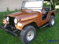 This 1960 Willys Jeep 90 % Restoration is in great
