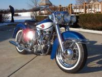 This is a 1960 Harley FLH DuoGlide in Hi Fi Blue with