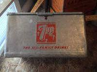 Right here is an extremely good 1960s 7UP cooler. Has a