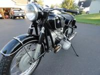: Red ___ 1961 BMW R69S. If this is genuine or not,