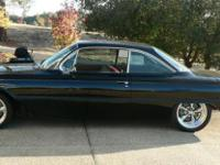 This is a rare 1961 Buick LeSabre Bubbletop that has