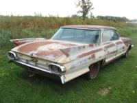 4 door, wrap around rear window, complete car with some