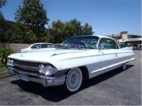 An awesome cruiser! A long and low 61 Caddy 2 door