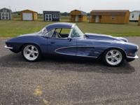 This is a 1961 Chevy Corvette, Complete Rebuild with no