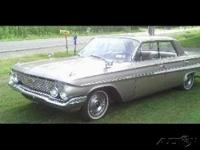 This 1961 Chevy Impala Sport Sedan is ready to inspire