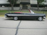 A beautifully brought back 1961 Impala convertible with
