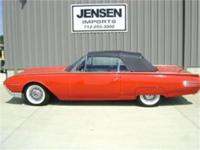 This 1961 Ford Thunderbird convertible Monte Carlo Red