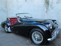1961 Triumph TR3 1961 Triumph TR3, black with red