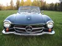 This is a beautifully restored 190SL roadster in
