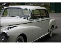 1962 Mercedes 300D Adenauer. White with tan interior.