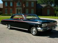 1962 chevy impala coupe with the factory original 327