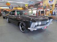 Here is an awesome 1963 Riviera! Black on Black 18s on