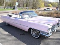 This car is Pink inside and out with tutone white and