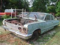 You are looking at a 1963 Chevy Biscayne 2 door sedan