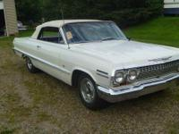 An eye catching 1963 Impala convertible. I have owned