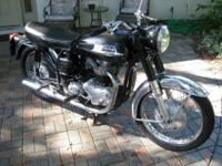This is a 1963 Norton Atlas 750. This bike is in very