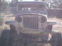 1963 Willys Wagon sitting on Chev 1/2 ton running gear.