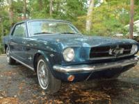 This is a 1964  (early 1965) Mustang Coupe with the