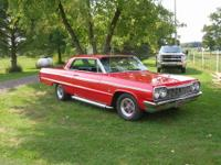 This is a very sharp and clean 1964 Chevy Impala SS