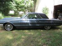 It is blue with blue interior and has leather seats,