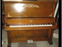 Refurbished 1964 Howard upright piano.  Well